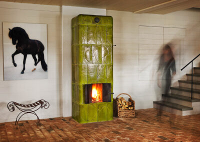 Free-standing, green tiled stove