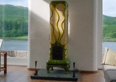 Naples yellow tiled stove, with green looping ornaments (Scotland)
