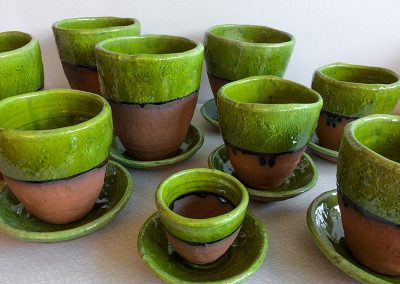 Green-glazed rough pots with plates