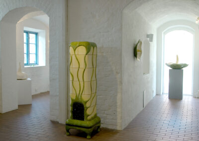 Naples yellow tiled stove, with green looping ornaments (Gothenburg)